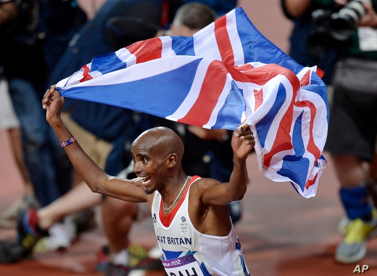 FILE - Britain's Mo Farah celebrates winning gold in the men's 10,000-meter final at Olympic Stadium at the 2012 Summer Olympics, London, Aug. 4, 2012. Farah who moved to Britain as a child from his native Somalia.
