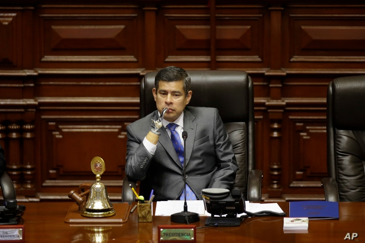 National Congress President Luis Galarreta presides over a special session on whether to initiate impeachment proceeding against the country's president, in Lima, Peru, Dec. 15, 2017.  Lawmakers went onto to approve impeachment proceedings against Pr...