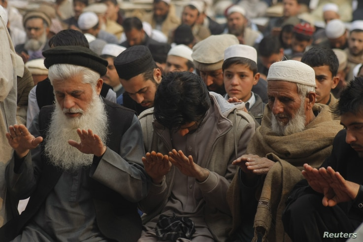 People attend special prayers for rain in Peshawar, Pakistan, Dec. 30, 2016. Lack of winter rains in the country has caused problems for farmers.