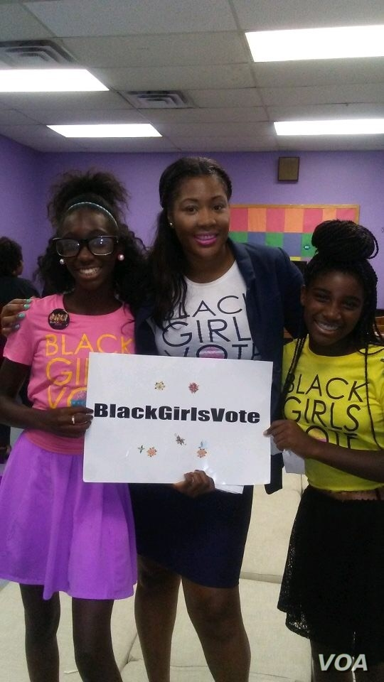 """Nykidra """"Nyki"""" Robinson (center) with two girls at a Black Girls Vote event."""
