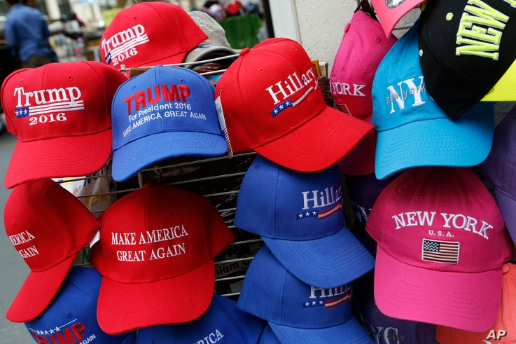 Hats displaying support for Democrat Hillary Clinton and her opponent Republican presidential candidate Donald Trump are displayed by a sidewalk vendor in New York, Aug. 16, 2016.