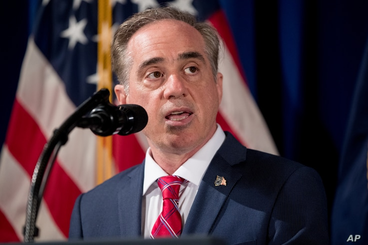 """Veterans Affairs Secretary David Shulkin speaks before President Donald Trump signs an Executive Order on """"Improving Accountability and Whistleblower Protection"""" at the Department of Veterans Affairs in Washington, April 27, 2017."""