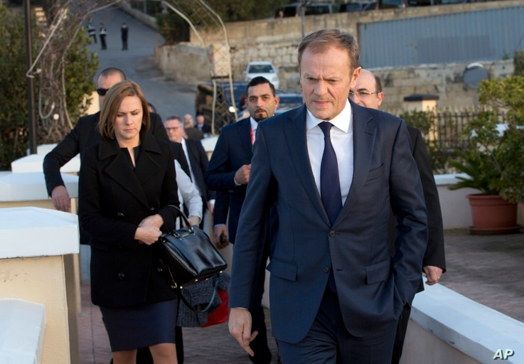 European Council President Donald Tusk, second right, prepares to address the media prior to an EU summit outside his hotel in Valletta, Malta on Thursday, Feb. 2, 2017.