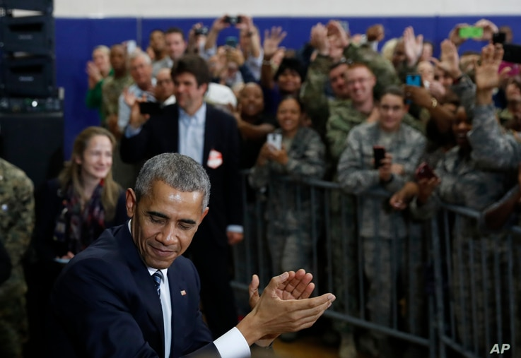 President Barack Obama turns to leave after speaking to and greeting service members at MacDill Air Force Base in Tampa, Fla., Dec. 6, 2016.