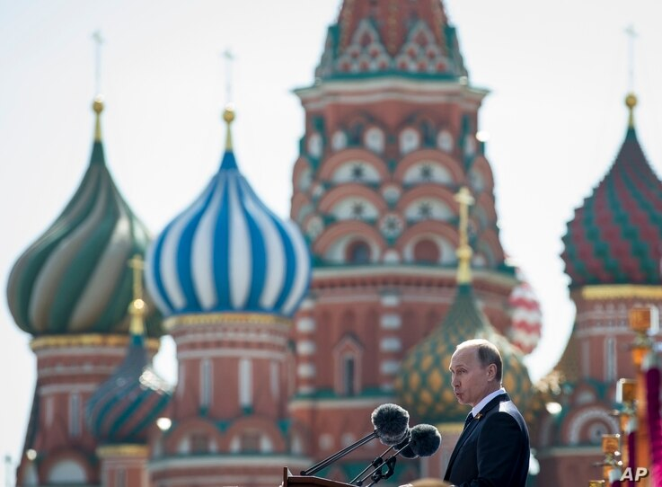 Russian President Vladimir Putin addresses the Victory Parade marking the 70th anniversary of the defeat of the Nazis in World War II, in Red Square, Moscow, Russia, May 9, 2015, with the St. Basil's Cathedral is in the background.