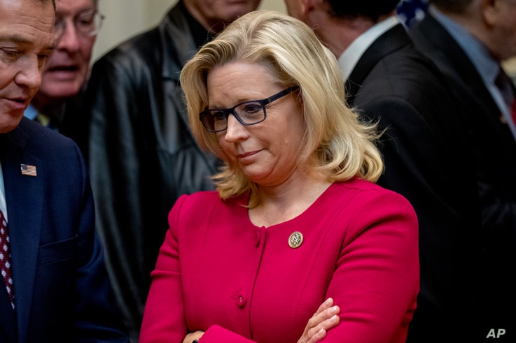 Rep. Liz Cheney, R-Wyo, waits for President Donald Trump to arrive to sign various bills in the Roosevelt Room of the White House, March 27, 2017, in Washington.