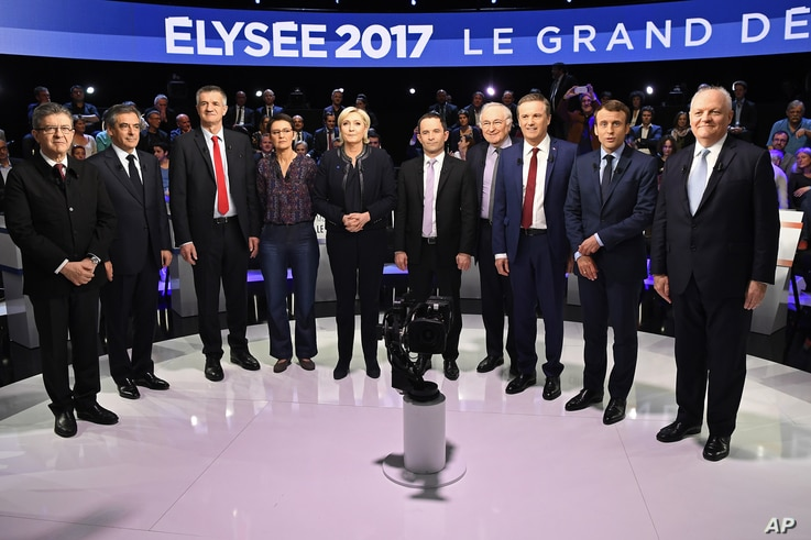Candidates in France's presidential race pose for a group photo prior to a television debate at French private TV channels BFM TV and CNews, in La Plaine-Saint-Denis, outside Paris, April 4, 2017.