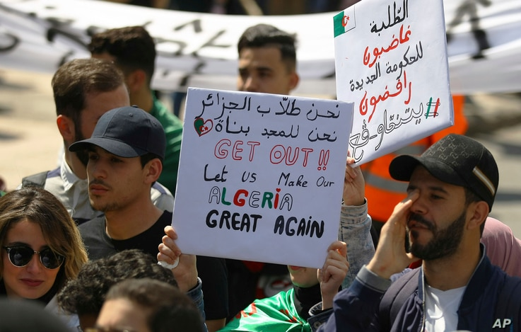 Algerian students march with placards during a protest in Algiers, Algeria, Apr. 2, 2019.