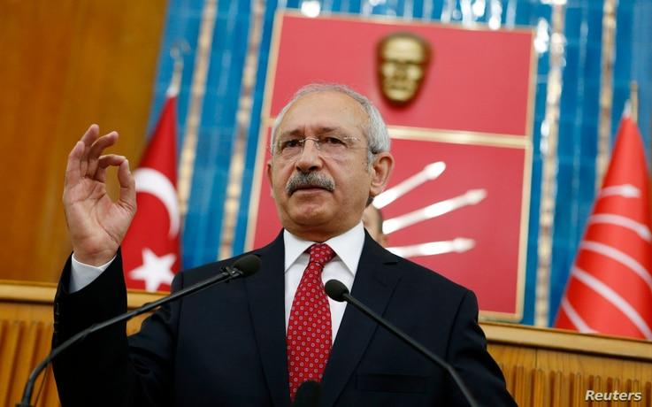 Turkey's main opposition Republican People's Party (CHP) Leader Kemal Kilicdaroglu addresses his party MPs during a meeting at the Turkish parliament in Ankara April 8, 2014. REUTERS/Umit Bektas (TURKEY) - RTR3KEBT