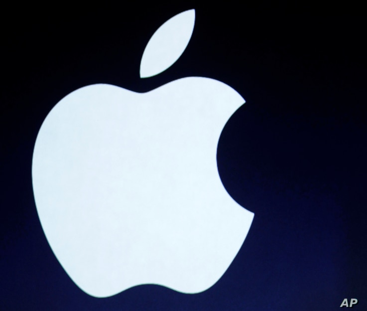 FILE - The Apple logo is projected during an announcement in San Francisco.