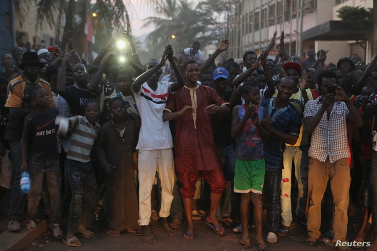 People cheer Malian soldiers in front of the Radisson hotel in Bamako, Mali, Nov. 20, 2015.