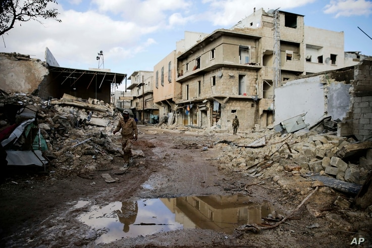Syrian army soldiers patrol the east Aleppo neighborhood of Tariq al-Bab, Syria, Dec. 3, 2016. Tariq al-Bab was captured by Syrian government forces on Friday.
