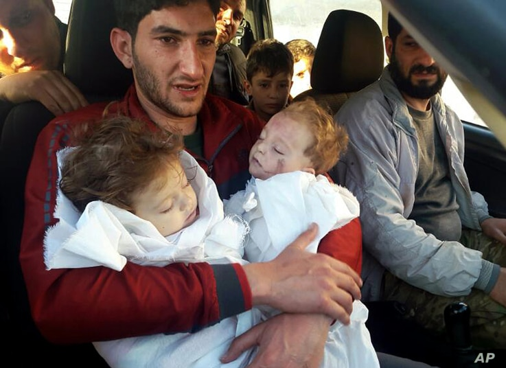 Abdul-Hamid Alyousef, 29, holds his twin babies who were killed during a suspected chemical weapons attack, in Khan Sheikhoun in the northern province of Idlib, Syria, April 4, 2017.