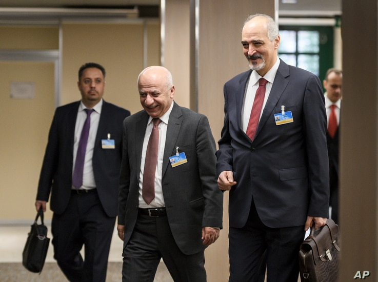Syrian ambassador to the United Nations and head of the government delegation Bashar al-Ja'afari (R) and his delegation arrive for a meeting with the UN Special Envoy for Syria Staffan de Mistura during Intra Syria peace talks, Dec. 14, 2017 at the E...