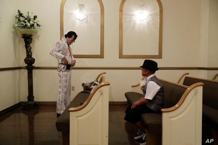Eddie Powers prepares to perform a wedding at the Shalimar Wedding Chapel in Las Vegas, Aug. 1, 2017. Elvis impersonators remain a staple of Las Vegas kitsch, performing in wedding chapels and casino venues and on street corners.