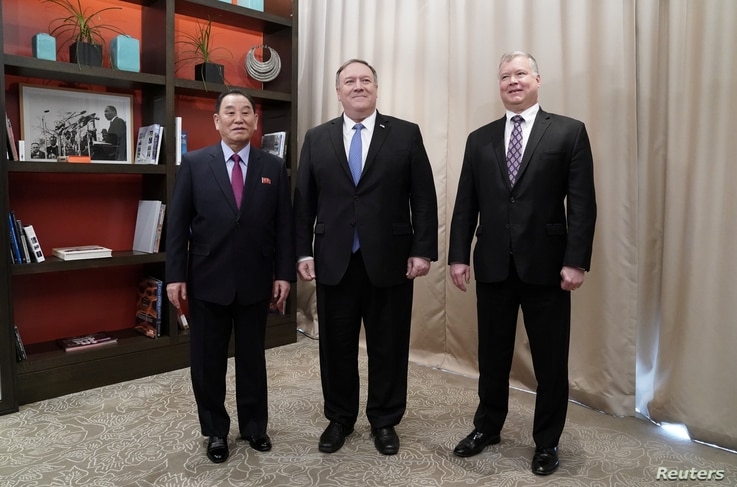 U.S. Secretary of State Mike Pompeo poses with Vice Chairman of the North Korean Workers' Party Committee Kim Yong Chol, North Korea's lead negotiator in nuclear diplomacy with the United States, and U.S. Special Representative for North Korea Stephe...