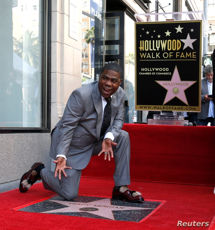 Actor Tracy Morgan poses on his star after it was unveiled on the Hollywood Walk of Fame in Los Angeles, California, April10, 2018.