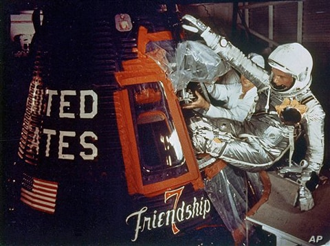 In this Feb. 20, 1962 file photo provided by NASA, astronaut John Glenn climbs into the Friendship 7 space capsule atop an Atlas rocket at Cape Canaveral, Fla., for the flight which made him the first American to orbit the earth.
