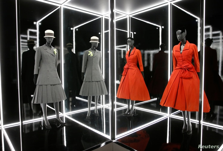 """Creations on display during a photocall for the """"Christian Dior: Designer of Dreams"""" exhibition at the Victoria & Albert (V&A) Museum in London, Jan. 30, 2019."""