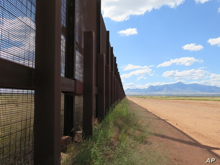 FILE - This Sept. 16, 2015 photo shows a part of the border fence near Naco, Ariz.