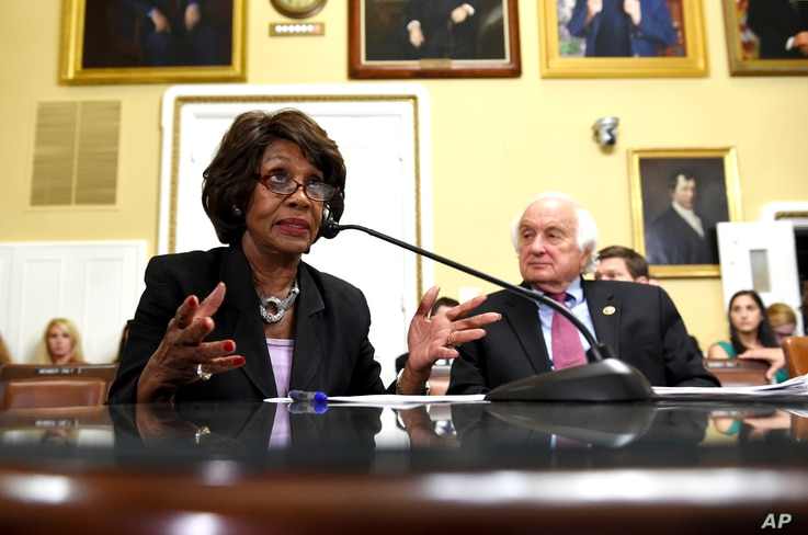 FILE - Rep. Maxine Waters, D-Calif., speaks next to Rep. Sander Levin, D-Mich., during a House Rules Committee meeting on the Iran nuclear deal in Washington, Sept. 8, 2015.