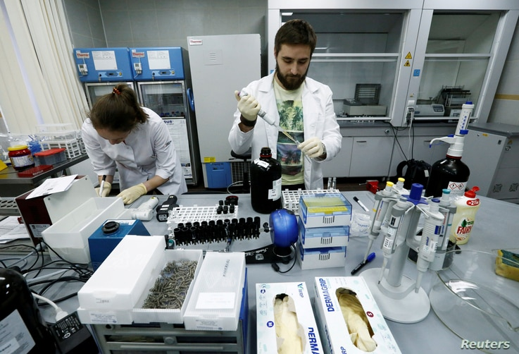 Technicians Ilya Podolsky and Natalia Bochkaryova work at the Russian anti-doping laboratory in Moscow, Russia, May 24, 2016.