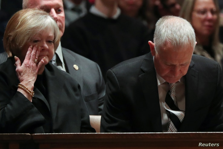 Judy and Dennis Shepard take their seats for a memorial service for the interment of the ashes of their late son Matthew Shepard.