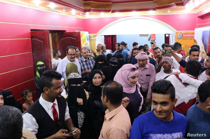 """People crowd outside a wedding hall where the local movie """"10 Days Before the Wedding"""" is being played in Aden, Yemen, Sept. 1, 2018."""