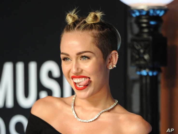 Miley Cyrus arrives at the MTV Video Music Awards on Aug. 25, 2013, at the Barclays Center in the Brooklyn borough of New York.