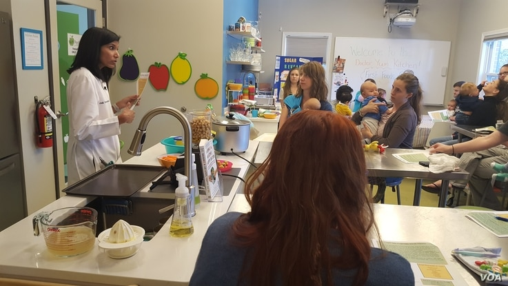 """Pediatrician Nimali Fernando, """"Dr. Yum,"""" leads a cooking class for new parents at her practice near Washington, DC."""