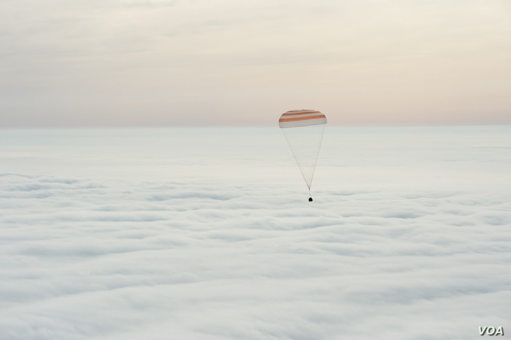 The Soyuz TMA-18M spacecraft is seen as it lands with Expedition 46 Commander Scott Kelly of NASA and Russian cosmonauts Mikhail Kornienko and Sergey Volkov of Roscosmos near the town of Zhezkazgan, Kazakhstan on Wednesday, March 2, 2016.