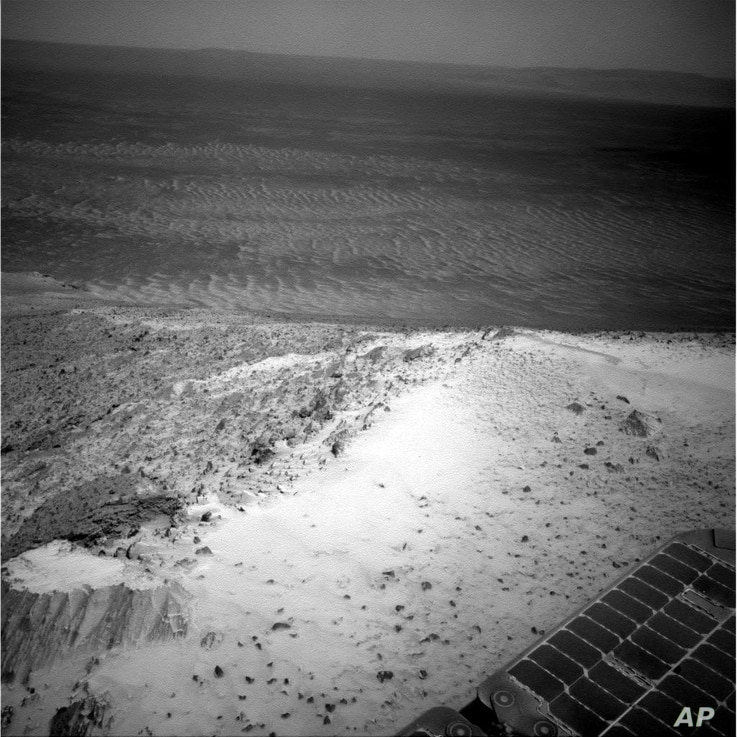 This image sent by NASA's Opportunity rover on Jan. 7, 2015 shows a view from atop a Martian hill. Opportunity spent several days at the summit making pictures that engineers will stitch into a color panorama.