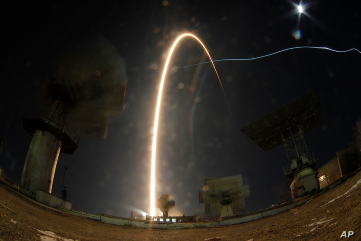 In this photo taken with long time exposure the Soyuz-FG rocket booster with Soyuz MS-03 space ship carrying a new crew to the International Space Station blasts off at the Russian leased Baikonur cosmodrome, Kazakhstan, Nov. 18, 2016.