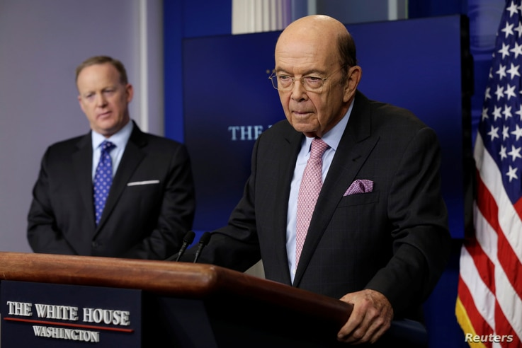 U.S. Commerce Secretary Wilbur Ross speaks next to White House press secretary Sean Spicer about new tariffs on Canadian softwood lumber from the White House in Washington, April 25, 2017.