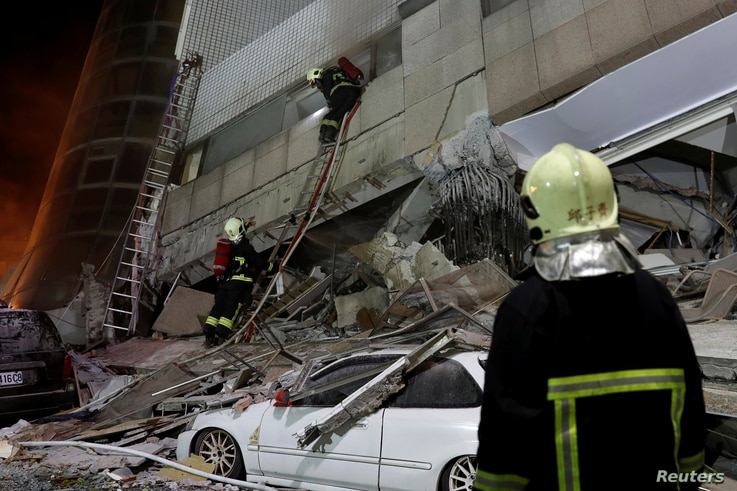 A fireman works at a collapses building after earthquake hit Hualien, Taiwan, Feb. 7, 2018.