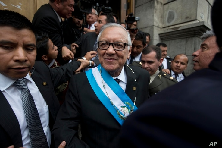 Guatemala's new President Alejandro Maldonado leaves the Congress building after his swearing-in ceremony in Guatemala City, Sept. 3, 2015.