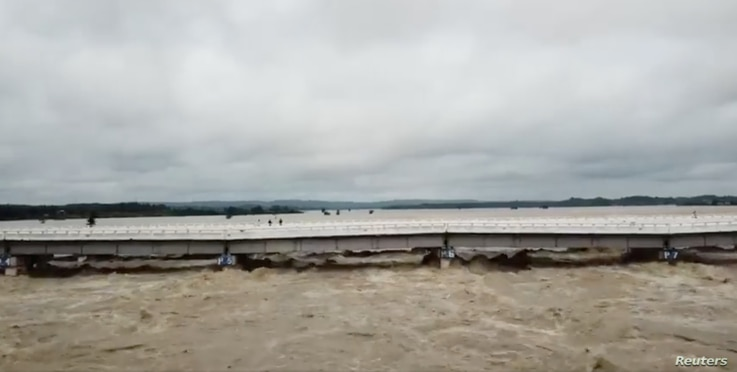 A bridge is seen after a dam breach flooded the area in Swar township, Myanmar, Aug. 29, 2018, in this still image from video obtained from social media.