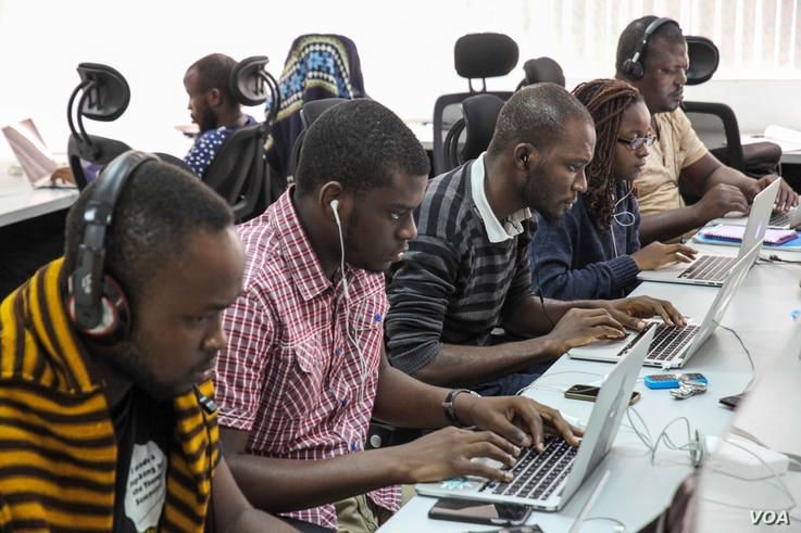 Andela fellows work on projects at the company's office on June 30, 2016 in Lagos, Nigeria. (Photo: Chris Stein for VOA)