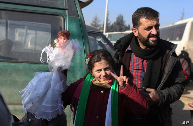 Syrians evacuated from the embattled Syrian city of Aleppo during the ceasefire arrive at a refugee camp in Rashidin, near Idlib, Syria, Dec. 20, 2016.