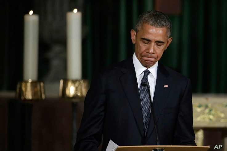 President Barack Obama pauses while delivering the eulogy in honor of former Delaware Attorney General Beau Biden at St. Anthony of Padua Church in Wilmington, Del., June 6, 2015.