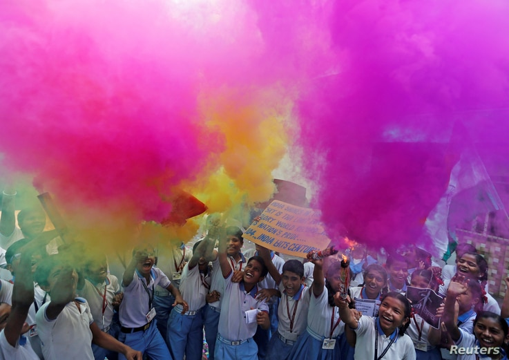 School children light fireworks as they celebrate India's Polar Satellite Launch Vehicle's (PSLV-C37) take off which carried 104 satellites in a single mission, at a school in Ahmedabad, India, Feb. 15, 2017.