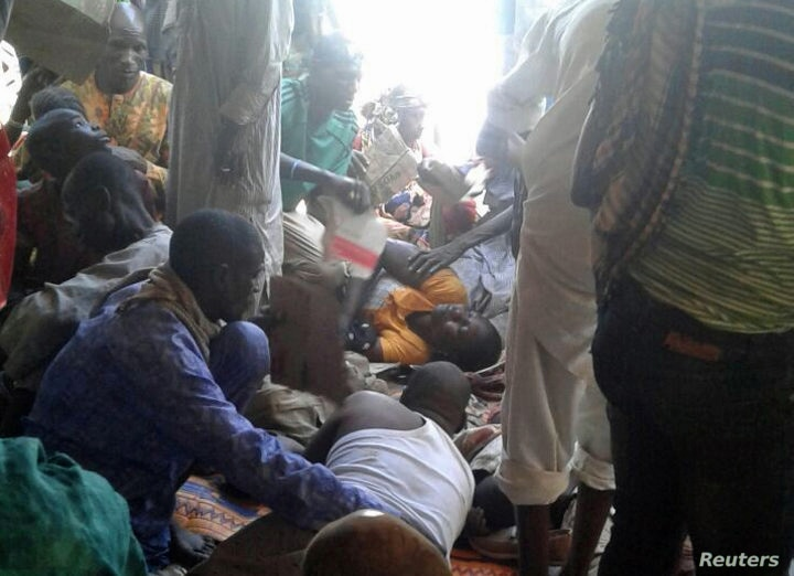 NIInjured people are comforted at the site after a bombing attack of an internally displaced persons camp in Rann, Nigeria, Jan. 17, 2017.