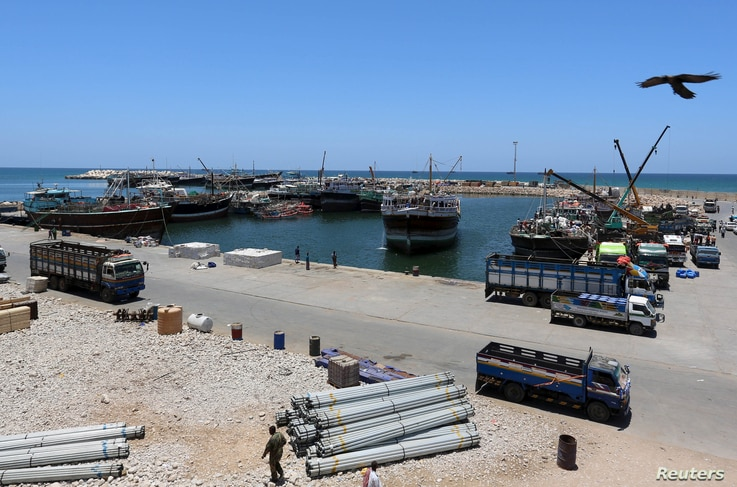 FILE - An eagle over flies at the Port of Bosaso in Somalia's Puntland, Apr. 19, 2015.