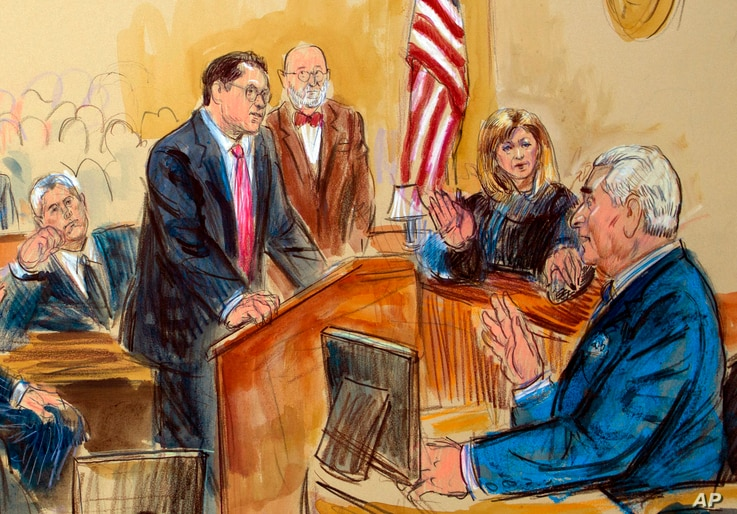 This courtroom sketch shows former campaign adviser for President Donald Trump, Roger Stone talking from the witness stand with prosecution attorney Jonathan Kravis, left, Stone's attorney Bruce Rogow, third from right, and Judge Amy Berman Jackson l...