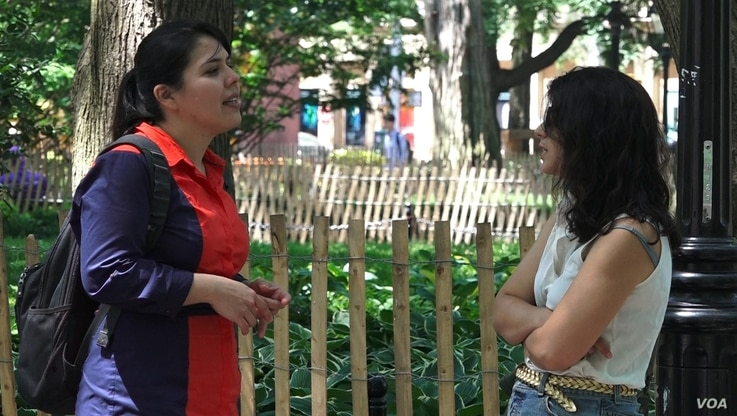 Arely Cordova (left), from Mexico, speaks to a friend on NYU Campus. Cordova says that when she came to the U.S., she realized the struggles that many minorities face in the labor market. (R. Taylor/VOA)