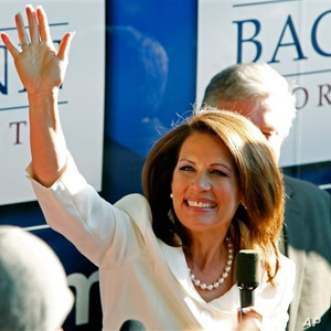 Republican presidential candidate Rep. Michele Bachmann, R-Minn., waves to supporters outside her campaign bus after being named the winner of the Iowa Republican Party's Straw Poll, Saturday, Aug. 13, 2011, in Ames, Iowa.