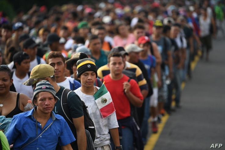 Honduran migrants take part in a caravan heading to the US on the road linking Ciudad Hidalgo and Tapachula, Chiapas state, Mexico, Oct. 21, 2018.