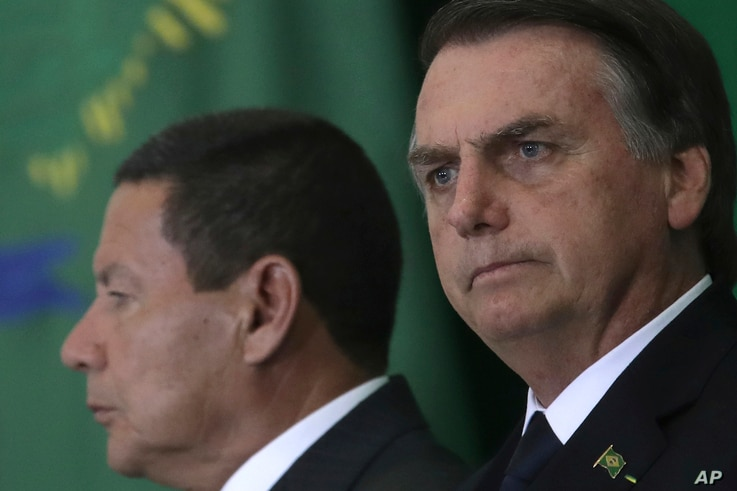 Brazil's President Jair Bolsonaro and his Vice President Hamilton Mourao attend a ceremony during which the country's government bank presidents are presented at Planalto presidential palace in Brasilia, Brazil, Jan. 7, 2019.