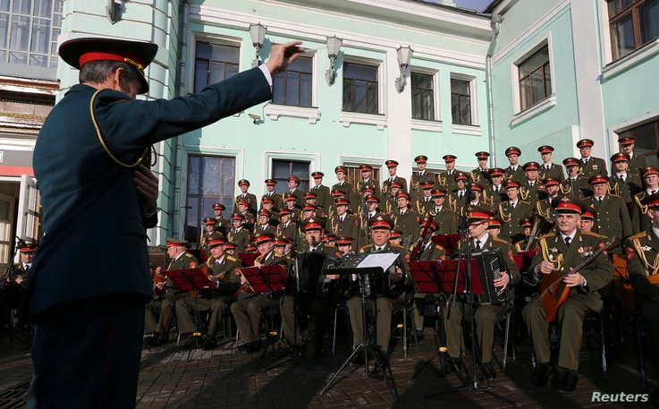 FILE -  Singers and orchestra members of Red Army Choir, also known as the Alexandrov Ensemble, perform in Moscow, Apr. 20, 2016.