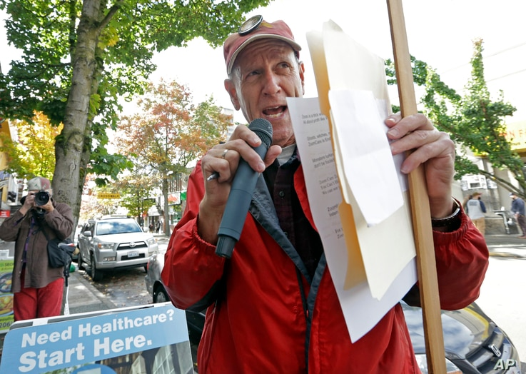 Robby Stern, a volunteer with the Puget Sound Advocates for Retirement Action and a proponent of Initiative 1501, leads a small protest over access for health care for senior citizens in Seattle, Oct. 18, 2016. The initiative would stiffen some penal...